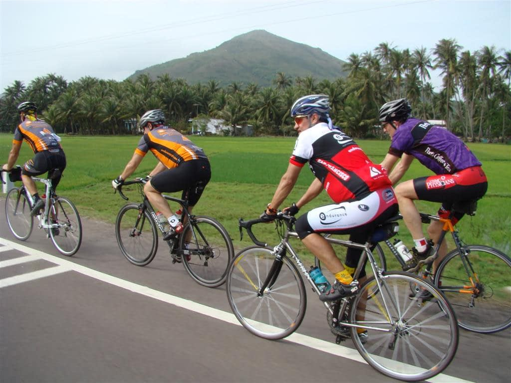 Bicyclists riding near Hoi An, Vietnam