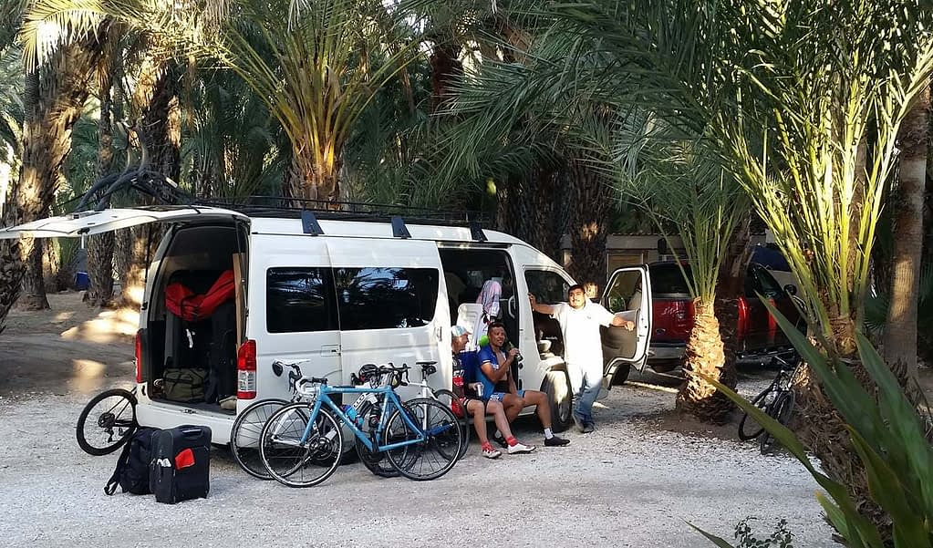 Mexico bicycle tour, Bicyclists resting in the support van during tour of Baja