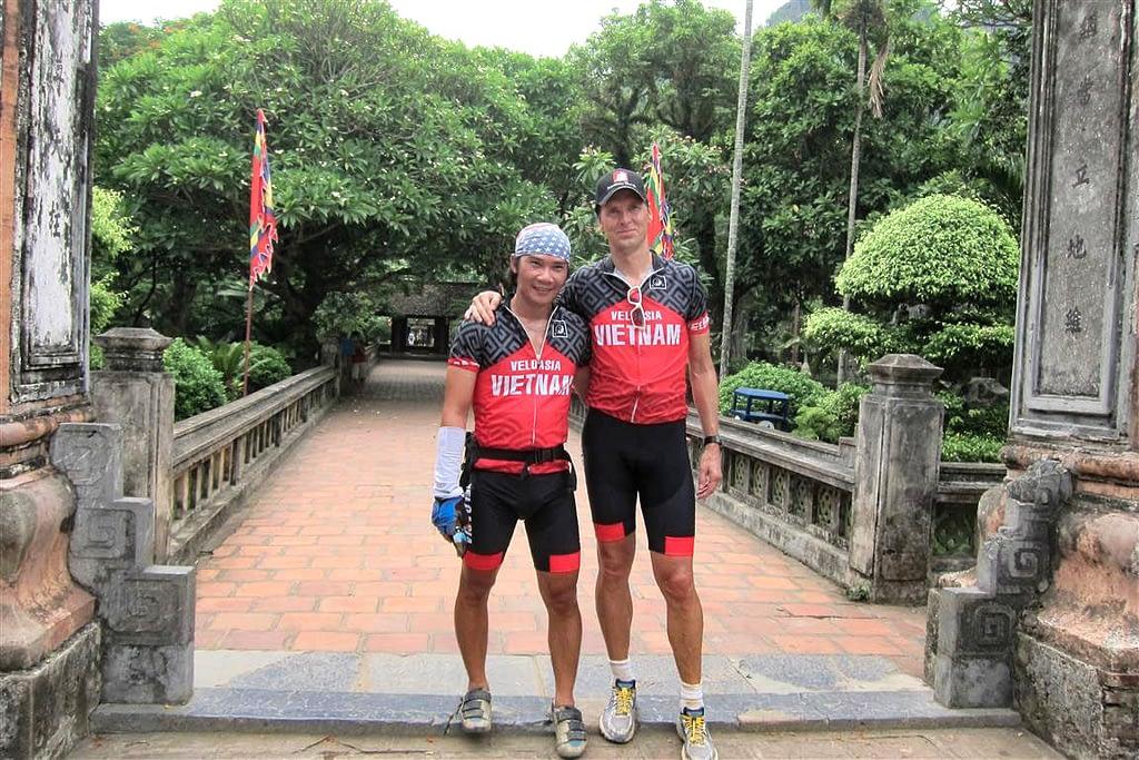 bicyclists visiting temple near Ninh Binh in Vietnam